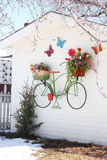 hanging black iron decorative bicycle and innovative ways to use it in your own home