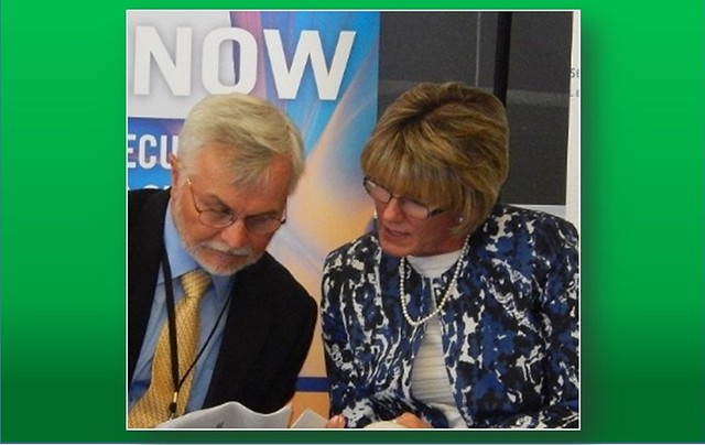 Dr. Mark Hufe, Director, Cyber Security Education at Wilmington University, confers with Delaware Chief Security Officer Elayne Starkey at the 2016 US Cyber Challenge.