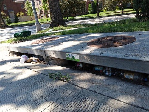 Bottles and cans stuck in sewer intake, Peabody Street NE at New Hampshire Avenue