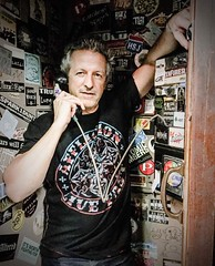 Joey from www.BruceintheUSA.com rocking his #afflictionclothing T on the road! #clothing #fashion #model #male #man #affliction #music
