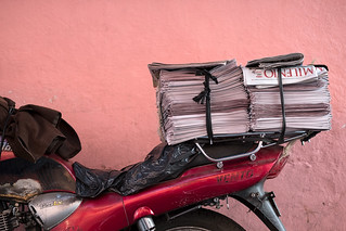 Newspaper delivery by motorbike