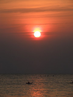 Kayaking on the beach in Goa on the backdrop of the setting sun