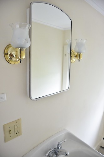 Original wall sconce - brass in a chrome room