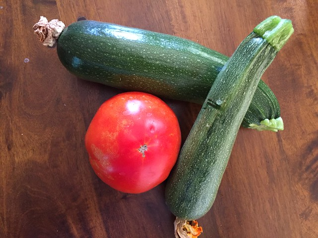 Zucchinis and a tomato