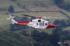HM Coastguard Search and Resuce AW.189 G-MCGT low level at Ullswater after performing a rescue near Fairfield