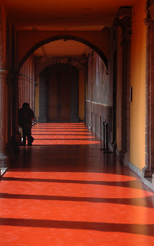 Orange Hallway in Mexico City with the Shadows of Arches