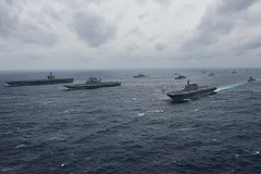In this file photo, ships from U.S. Navy, Indian Navy, and Japan Maritime Self-Defense Force sail in formation during Malabar 2017. (U.S. Navy/MC2 Cole Schroeder)