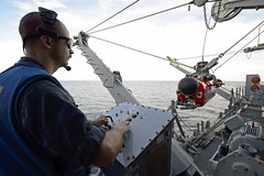 In this file photo, Mineman 1st Class Zachary Abel deploys a AN/SLQ-48 mine neutralization vehicle (MNV) from USS Pioneer (MCM 9) during Mine Warfare Exercise 2JA in 2017. (U.S. Navy/MC2 William McCann)