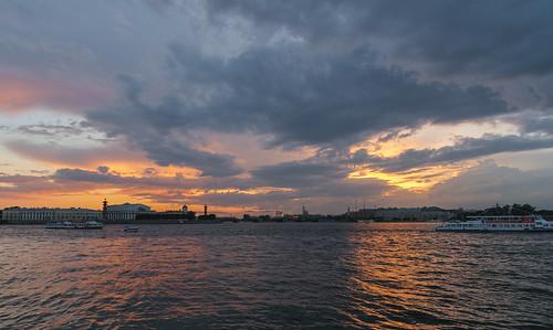 saintpetersburg russia clouds sky skyscape city cityscape building architecture water river neva sun sunset light orange boat