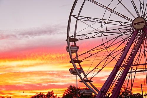 sunset ferris wheel color clouds sun salem virginia