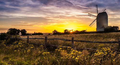 photography lanscape windmill sunset colours yellow sun fence flowers southdowns sussex lewes brighton falmer horse rollinghills beautiful location sky clouds blues orange explore