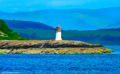 Scotland West Highlands a small lighthouse on the Island of Cumbrae 16 July 2017 by Anne MacKay