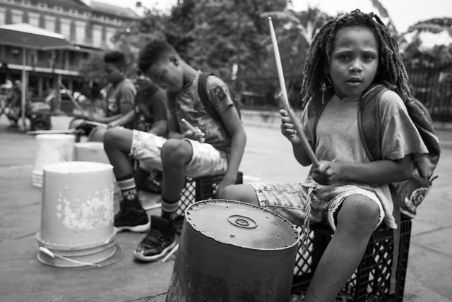 boy drumming on a plastic pail