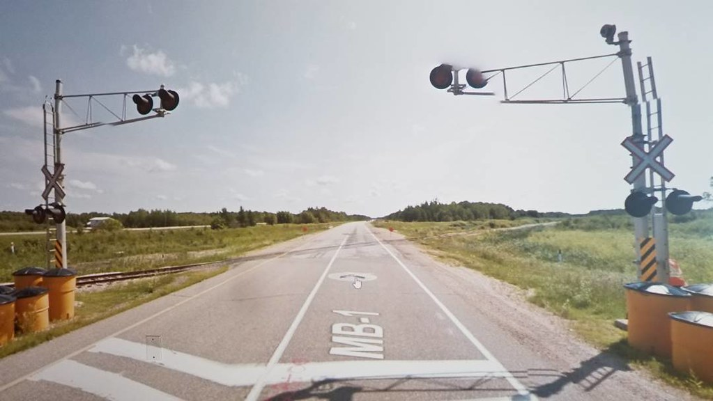 Glitched train crossing. #ridingthroughwalls #xcanadabike #googlestreetview #manitoba