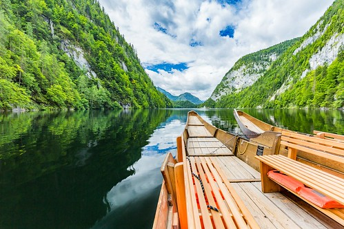 boat mountain serene foliage lake travel forest plants pier panorama rowing slovenia wood two trees outdoor navigation green brown julianalps landscape lakebled austria laketoplitz canon