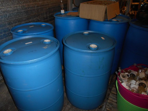 grapes in plastic barrels