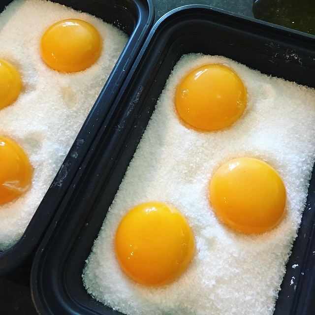 Salt-curing egg yolks. Will dig them out of the salt in 4 or 5 days.