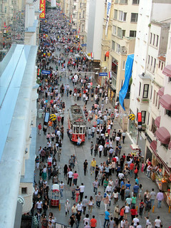 A tram, going along a busy street in Taxim, Istanbul