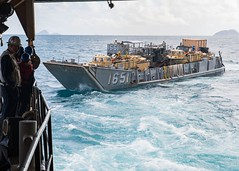 Sailors launch Landing Craft Utility from the well deck of USS Ashland.