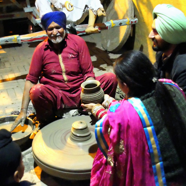 Newlyweds making pottery at Haveli