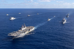 In this file photo, ships of the Bonhomme Richard Expeditionary Strike Group form up with ships from the Royal Australian Navy and Royal New Zealand Navy during exercise Talisman Saber in July. (Royal Australian Navy/LSIS Helen Frank)