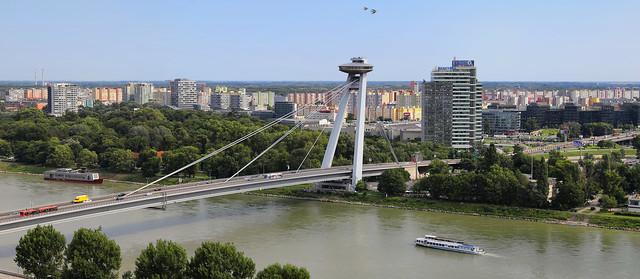 The sci-fi UFO bridge of Bratislava with concrete jungle looms behind