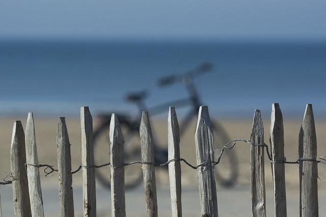 Bike behind fence on the beach