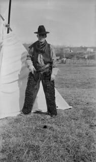 A cowboy in front of a tent, Hazelton, British Columbia / Cowboy devant une tente, Hazelton (Colombie-Britannique)