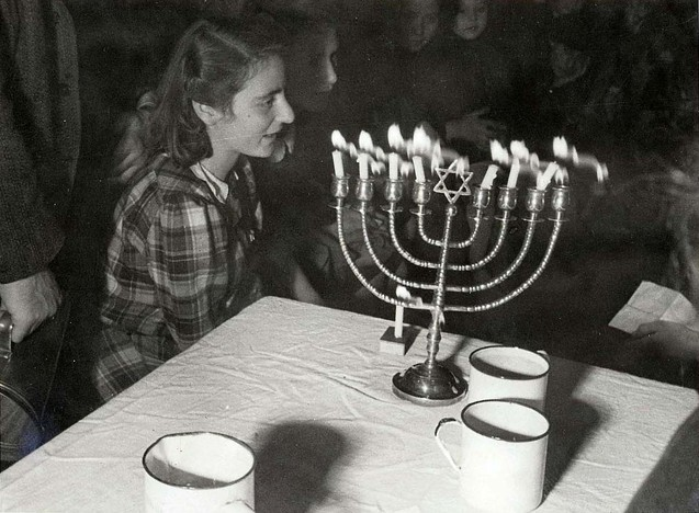 008---Westerbork, Holland, Lighting the candles on the seventh night of Hannukah 1943