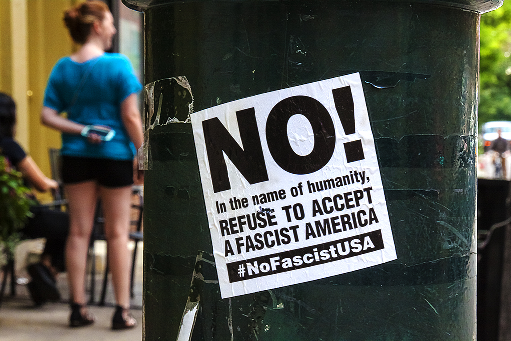 NO in the name of humanity sticker on 7-26-17--Center City