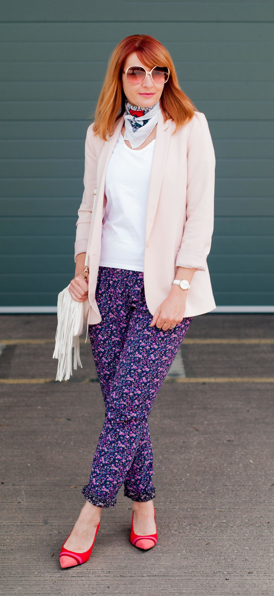 Summer dressing for cooler days: Pale pink blazer \ loose floral trousers \ red striped block heel shoes \ neck scarf \ white fringe cross body bag | Not Dressed As Lamb, over 40 style