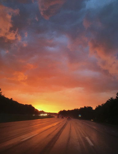 driving sunset rain orange clouds highway view
