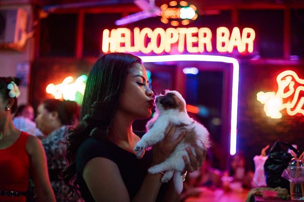 Cambodian girl with little dog, Phnom-Penh, Cambodia
