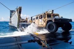 A Humvee is driven onto an LCU.