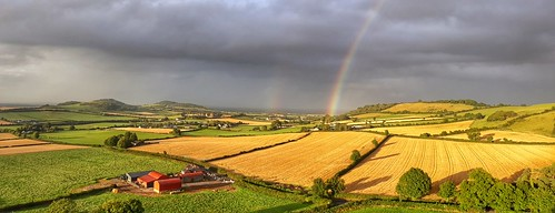 landscapes nature scenic countryside ireland sunset light clouds rain rainbow panoramic hills hilltop golden fields harvest outdoors exploring farm building houses