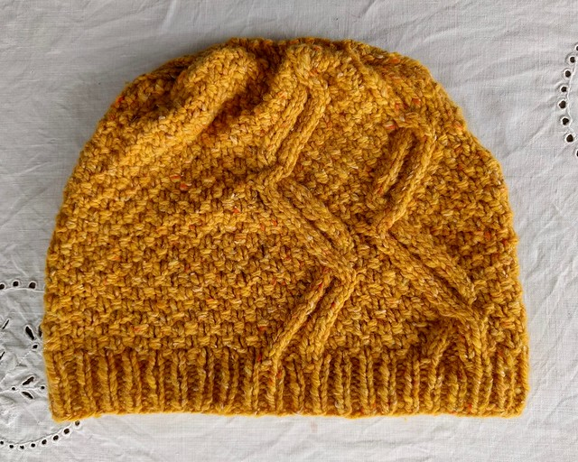 Yellow handknit hat.