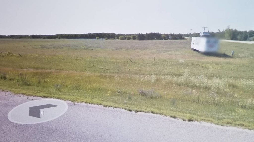 The identity of this face must be blurred for its protection. #ridingthroughwalls #xcanadabike #googlestreetview #manitoba