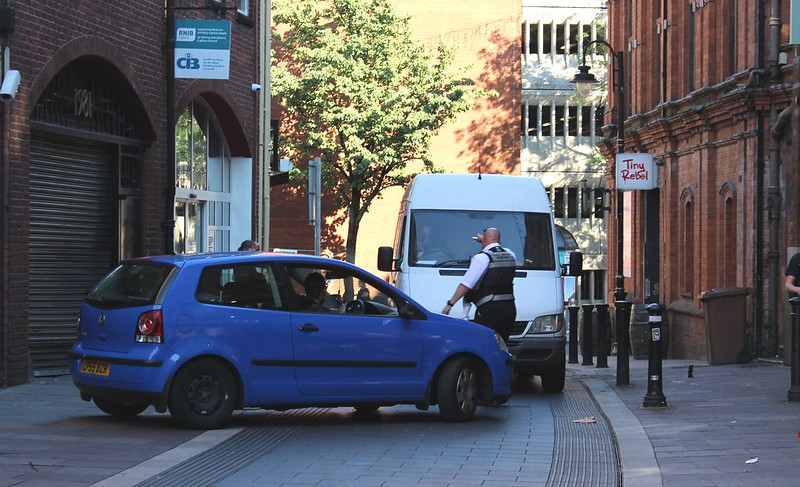 Parking officer in Cardiff orders vehicles out of a pedestrian area