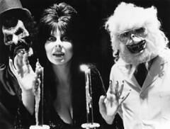 Elvira with monsters at Knott's Berry Farm, mid-1980s