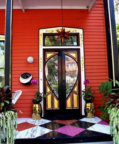 red house old ontheharbor wood offthebeatenpath saintaugustineflorida necoast unitedstates wraparoundbalconies grandentrance steps railing quietstreet looksoutovertheharbor harborview architecture outdoor building eastcoast window frontdoor eclectic color fancyfrontdoor occupiedresidentialhome ferns wallsconce intercom goldtrim transomwindow doorbell redstaroutsidelight deckdiamondpaintpattern entrance frenchdoors