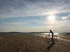 Cycling on the Beach by Len Radin