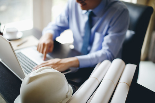 Business man engineering using laptop