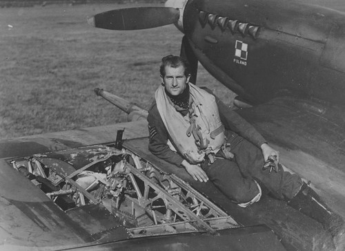Polish RAF Pilot Squadron sits on the damaged Spitfire MK-IX in Belgium 1944-1945
