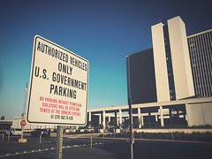 Text Communication Guidance Road Sign Built Structure Architecture Clear Sky Day Road Building Exterior Low Angle View Outdoors Sky City Government Police Federal at Federal Building