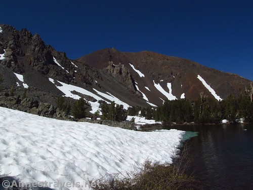 Hiking along the uppermost Frog Lake along the Virginia Lakes Trail in the Hoover Wilderness of California
