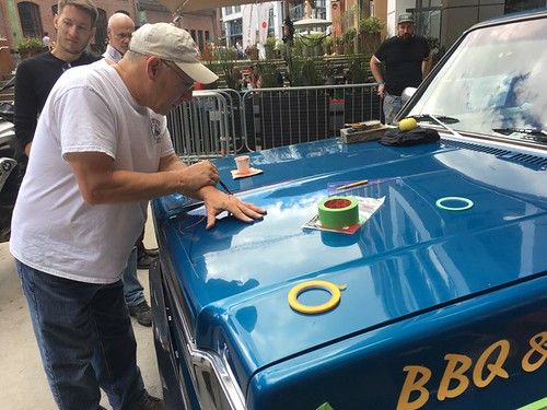 The legendary Bob Behounek adds pinstripes to the truck project.