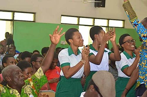 Students celebrate after a victory for St Louis Senior High School at a regional quiz