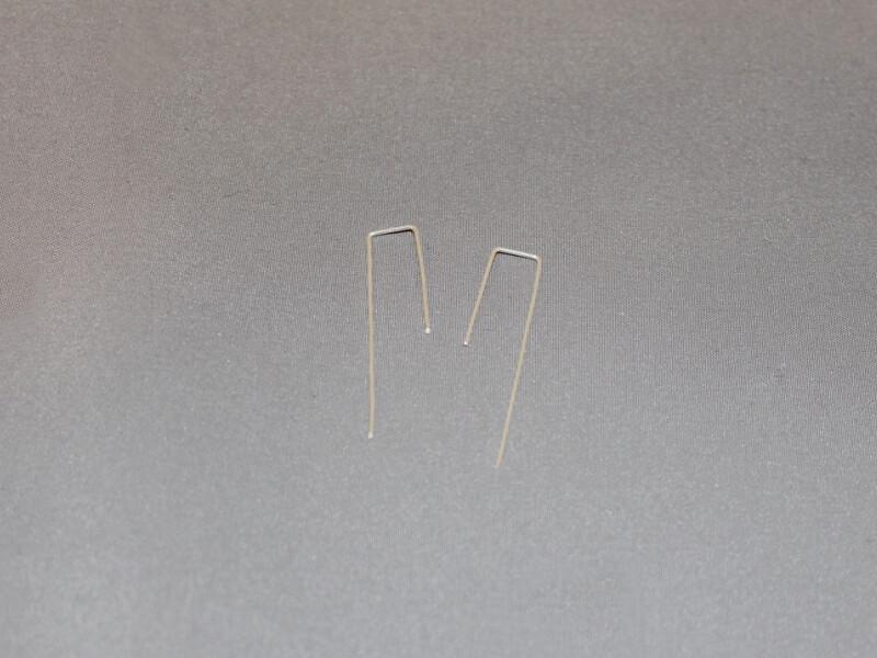 two bent earrings