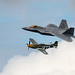 P-51D being escorted by an F22 Raptor