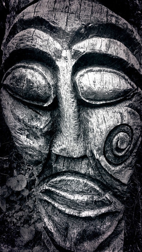 carved wooden face from Henllys Iron Age Fort, Wales